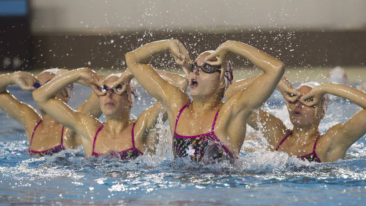 The swimmers work on their artistry and timing.