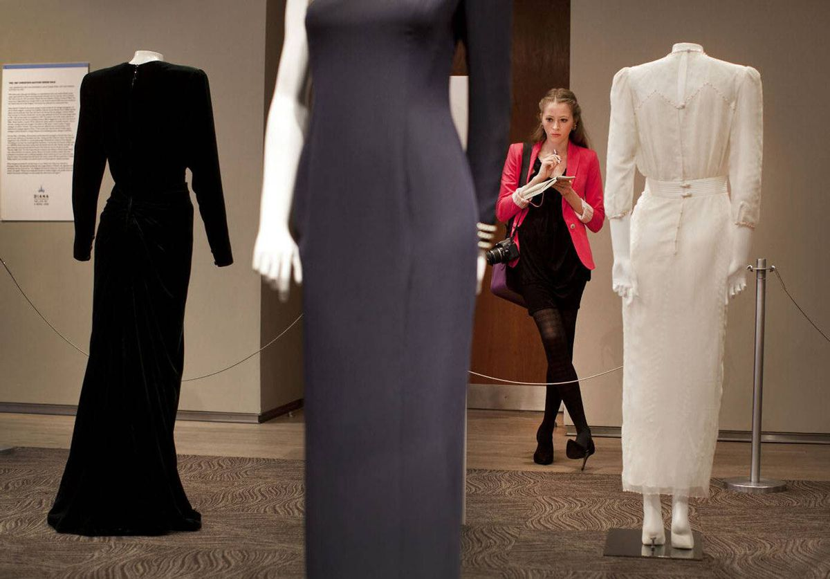 Natalie Ast looks at a collection of dresses worn by Princess Diana on display at the Design Exchange in Toronto. Diana: The Life of a Royal Icon dress exhibition runs until June 10.