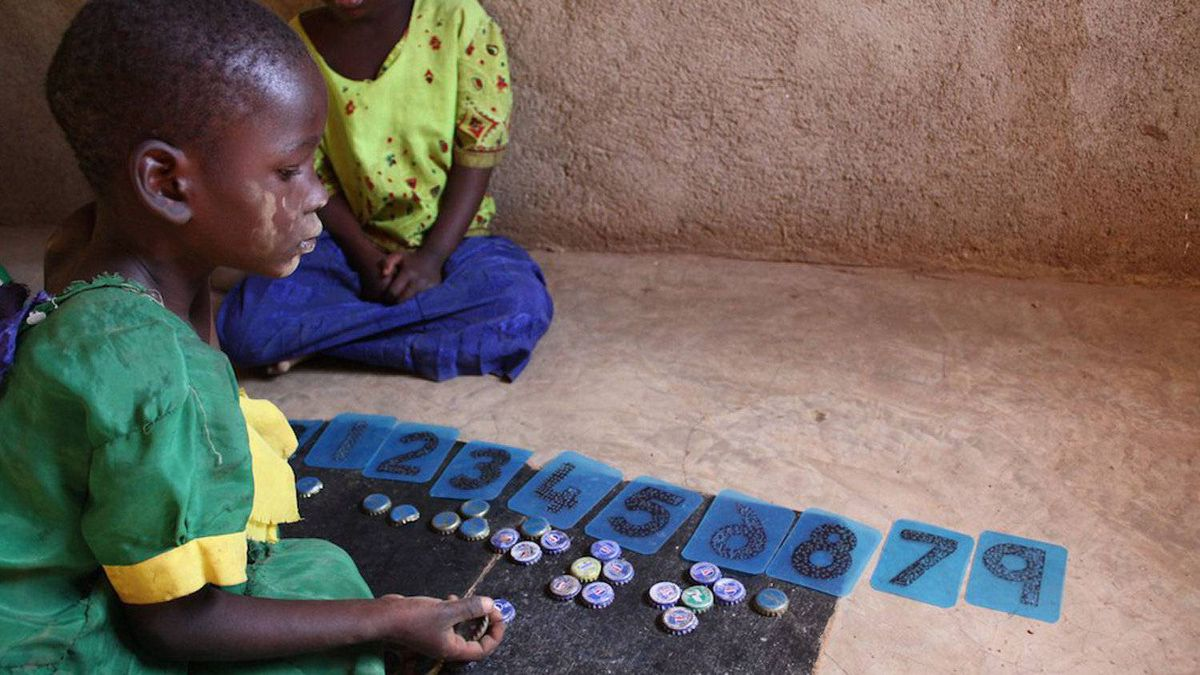 A child practices counting at a school in the Tanzanian village of Azimio Mswiswi.