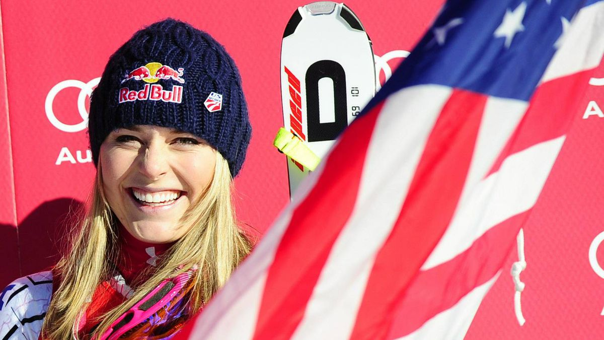 US skier Lindsey Vonn celebrates on the winners' podium in the Women's Super G of the FIS Ski World Cup in Lake Louise on December 5, 2010. Vonn won the race in a time of 1:20.72, Germanys Maria Riesch placed second and Julia Mancuso of the US finished third. Getty Images/Emmanuel Dunand