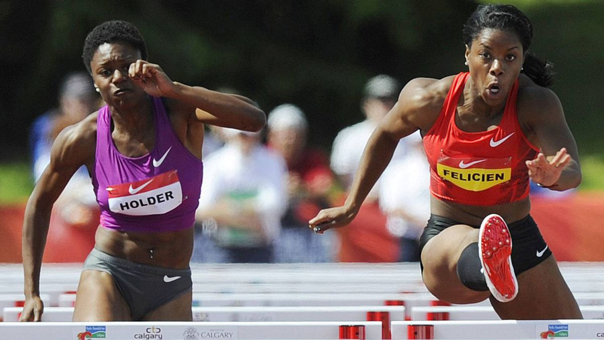 Perdita Felicien (R) clears a hurdle next to Nikkita Holder in the women's 100 meter hurdle finals at the Canadian Track and Field Championships in Calgary, Alberta, June 25, 2011. Felicien went on to win the hurdle event. REUTERS/Todd Korol