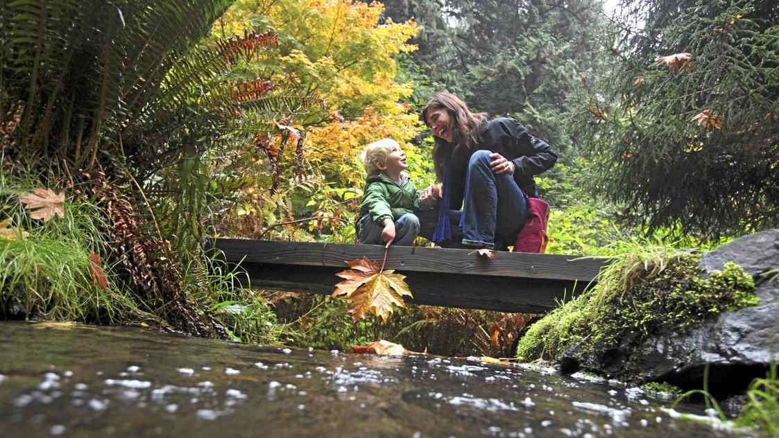 Julie Barlow and her son Dexter Heath, 4, share a moment along Charlie's Trail at Royal Roads University near Victoria,BC.