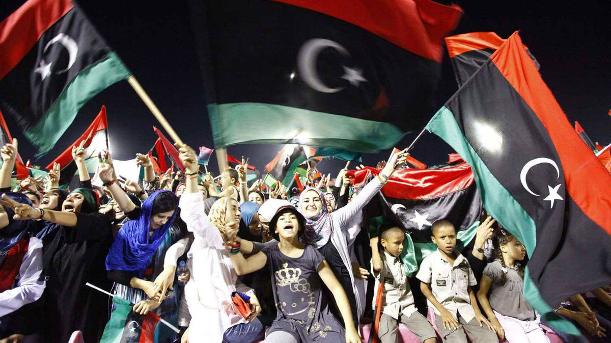 Libyans chant slogans and hold Kingdom of Libya flags as they celebrate during a gathering against ousted leader Muammar Gaddafi on Martyrs Square, known under Gaddafi as Green Square, in Tripoli September 9, 2011.
