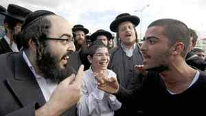An ultra-Orthodox man argues with a secular counterpart during a protest about religious zealotry in Beit Shemesh, Israel.