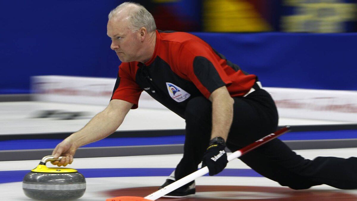 Ontario skip Glenn Howard delivers a stone during play against Alberta at the Brier curling championships in Halifax, Nova Scotia, March 11, 2010. REUTERS/Shaun Best