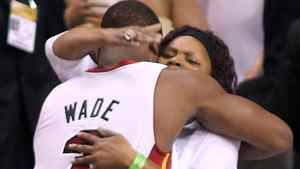 Dwyane Wade #3 of the Miami Heat greets his mother Jolinda Wade prior to the start of Game 6. (Photo by Marc Serota/Getty Images)