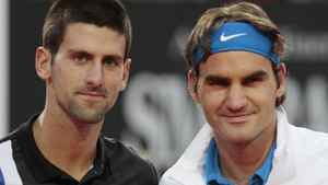 Serbia's Novak Djokovic, left, and Switzerland's Roger Federer pose for a picture prior to the start of a semifinal match at the Italian Open tennis tournament, in Rome, Saturday, May 19, 2012. (AP Photo/Gregorio Borgia)