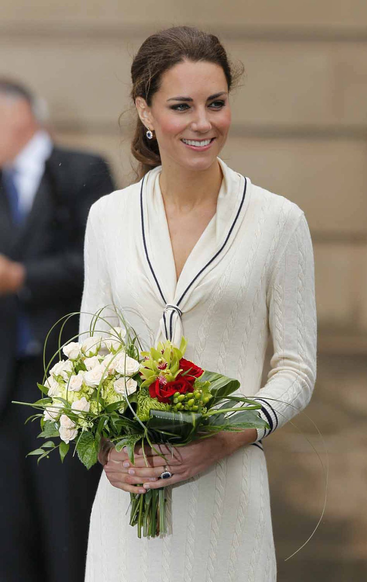 At a July 4 ceremony in Charlottetown, Kate gets into the Maritime feel with a sailor-style dress by Alexander McQueen.
