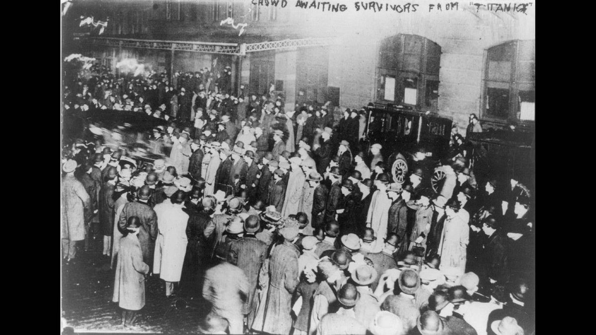 A crowd in New York awaiting survivors from the Titanic to arrive aboard the Carpathia following the sinking of the Titanic, April 18, 1912.
