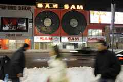 The spinning records above Sam The Record Man on Yonge Street in Toronto went dark after the iconic store shut down. Today, they have been torn down.