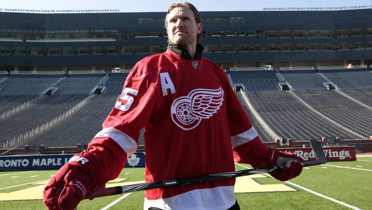 Detroit Red Wings player Niklas Kronwall stands on the field at Michigan Stadium in Ann Arbor, Michigan February 9, 2012, following an announcement that the Red Wings will host the Toronto Maple Leafs at Michigan Stadium on the University of Michigan campus in the 2013 Bridgestone NHL Winter Classic. REUTERS/Rebecca Cook