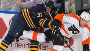 Matt Ellis #37 of the Buffalo Sabres checks Danny Syvret #26 of the Philadelphia Flyers in Game Six of the Eastern Conference Quarterfinals during the 2011 NHL Stanley Cup Playoffs at HSBC Arena at HSBC Arena on April 24, 2011 in Buffalo, New York. The Flyers won 5-4 in OT. (Photo by Rick Stewart/Getty Images)