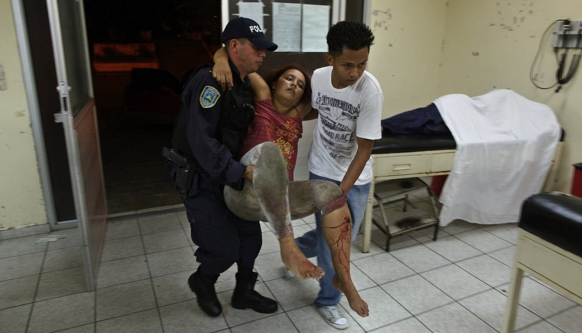 A woman who was injured during a shooting at a pool hall gets emergency medical attention from doctors and nurses at the Catalino Rivas Public Hospital in San Pedro Sula, Honduras, MArch 11, 2012.