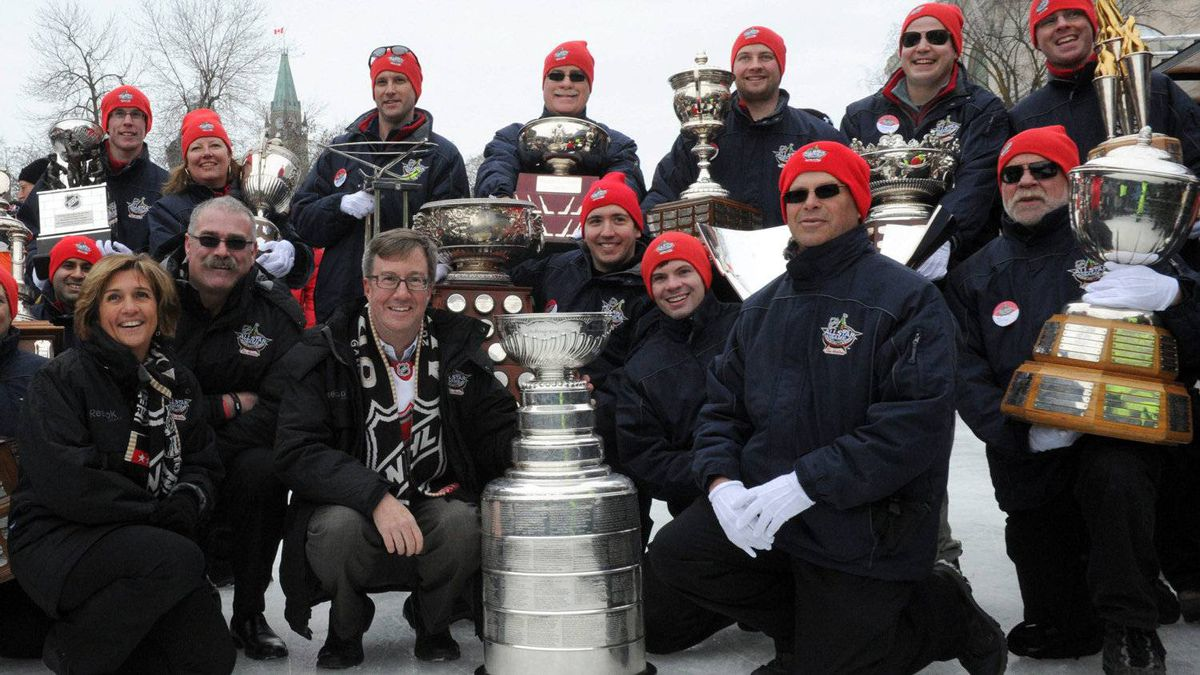 Ottawa Mayor Jim Watson holds the Stanley Cup along with Ottawa Senators head coach Paul MacLean, second from left, as the cups of the NHL are seen on the Rideau Canal Skateway during the opening ceremonies to the All-Star weekend in Ottawa on Thursday, January 26, 2012. The Stanley Cup was last seen on the Rideau Canal in 1905.