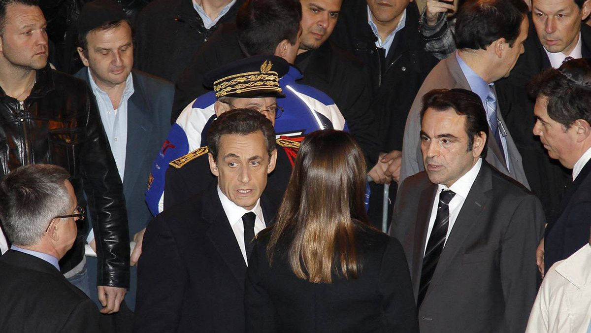 French President Nicolas Sarkozy and his wife Carla Bruni-Sarkozy arrive at the Notre-Dame de Nazareth synagogue in Paris to pay tribute to the four victims killed by a gunman at a Jewish school in Toulouse, on March 19, 2012.