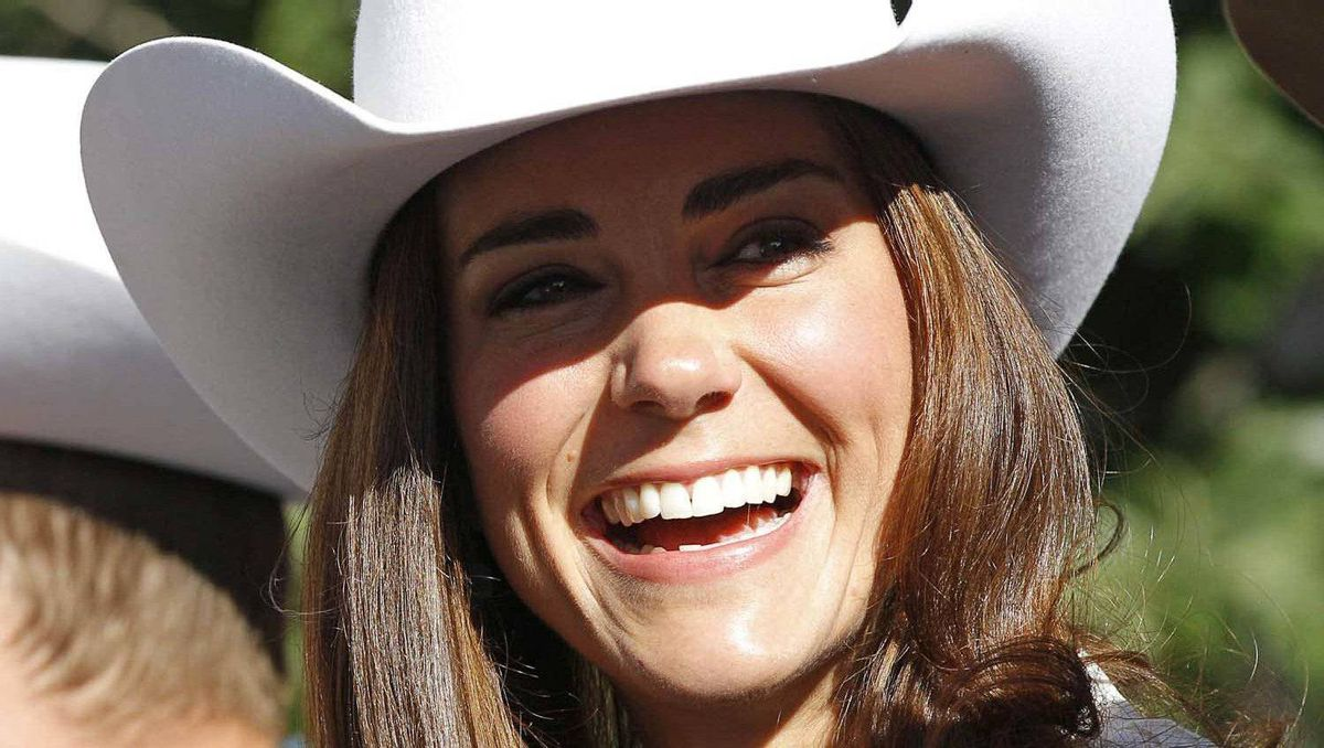 Catherine, Duchess of Cambridge, reacts during the official start of the Calgary Stampede parade in Calgary, Alberta, July 8, 2011.