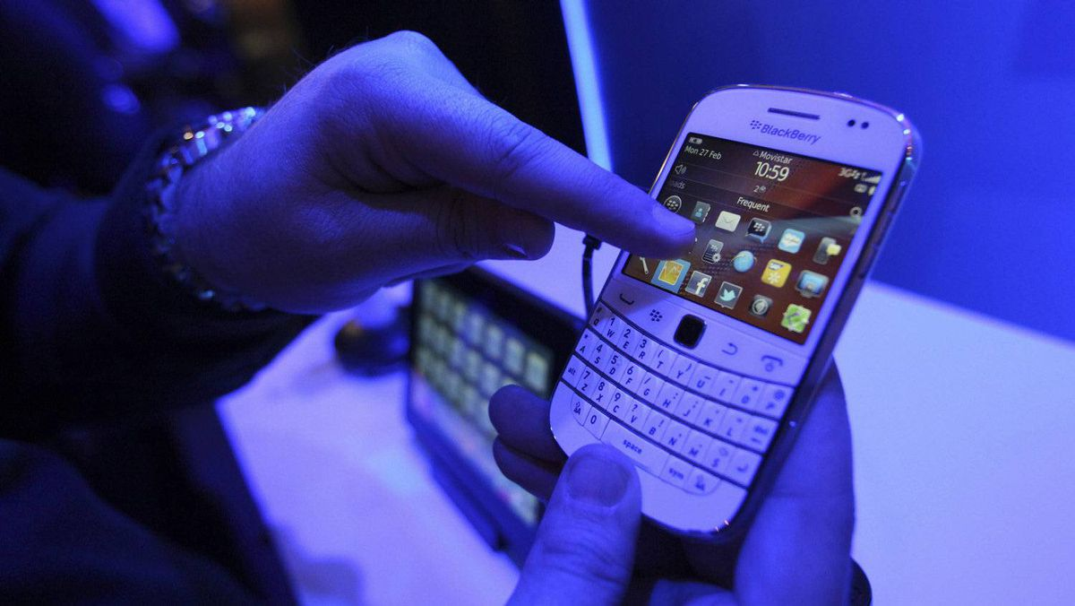 A visitor tests a Research In Motion Ltd. (RIM) Blackberry 9900 smartphone at the company's promotional stand at the Mobile World Congress in Barcelona, Spain, on Monday, Feb. 27, 2012.