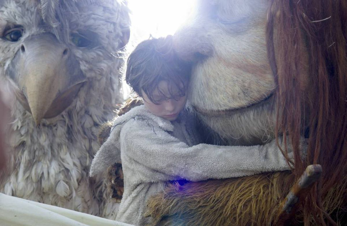 Douglas (voiced by Chris Cooper), left, and KW (Lauren Ambrose), right, console Max (Max Records) in Where the Wild Things Are.