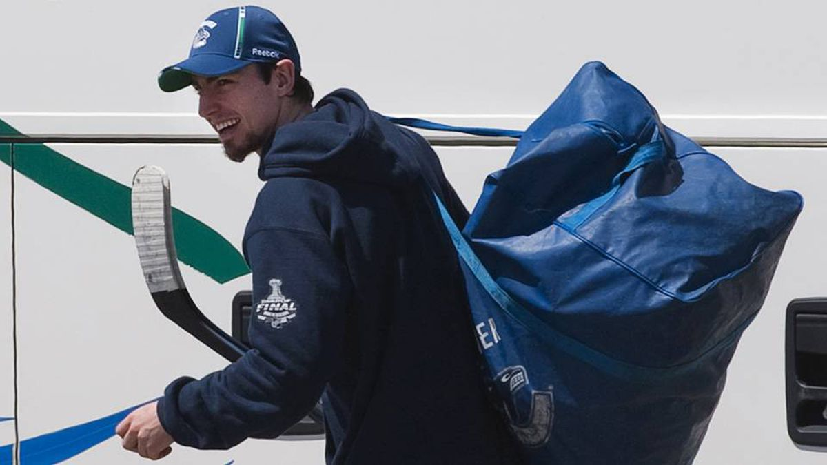 Vancouver Canucks' Alex Burrows departs after a team hockey practice for the NHL Stanley Cup in Vancouver, British Columbia June 3, 2011.