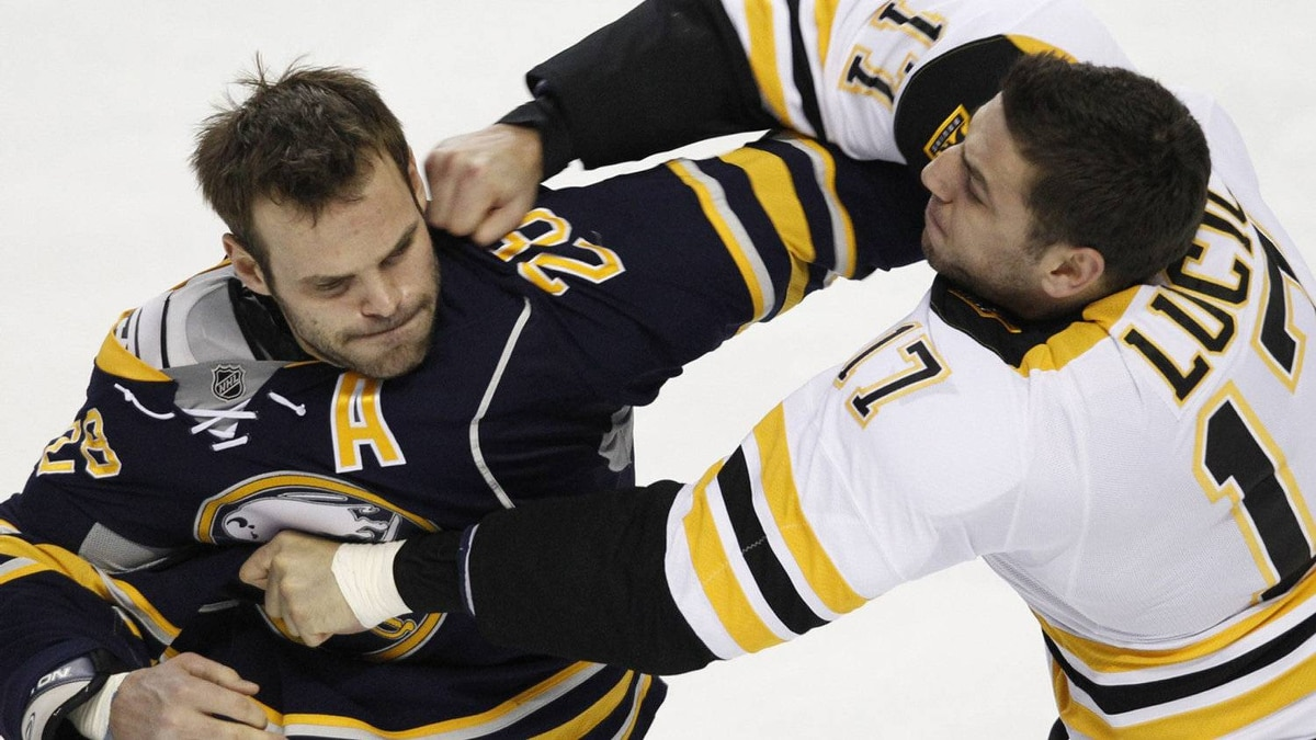 Buffalo Sabres' Paul Gaustad (28) and Boston Bruins' Milan Lucic (17) fight during the first period of an NHL hockey game at the First Niagara Center in Buffalo, N.Y., Friday, Nov. 23, 2011. (AP Photo/Derek Gee)