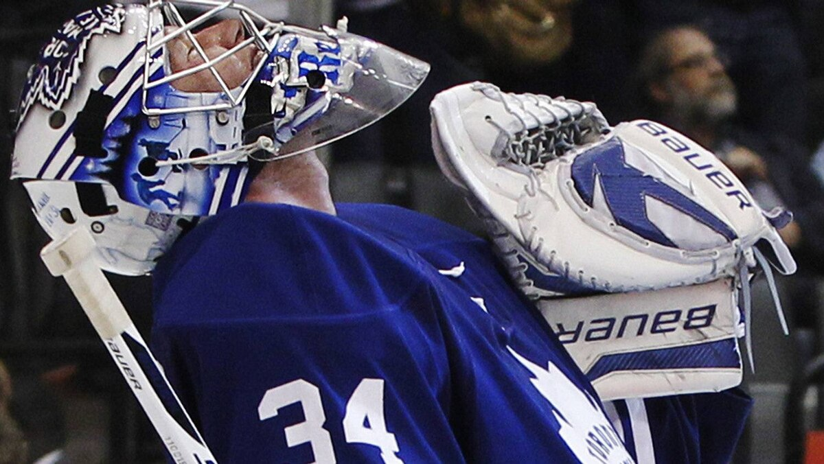 Toronto Maple Leafs goalie James Reimer celebrates his shutout against the Montreal Canadiens in their NHL hockey game in Toronto, October 6, 2011. The Leafs and Habs are both off to military boot camp Globe and Mail hockey reporter David Shoalts writes. REUTERS/Mark Blinch