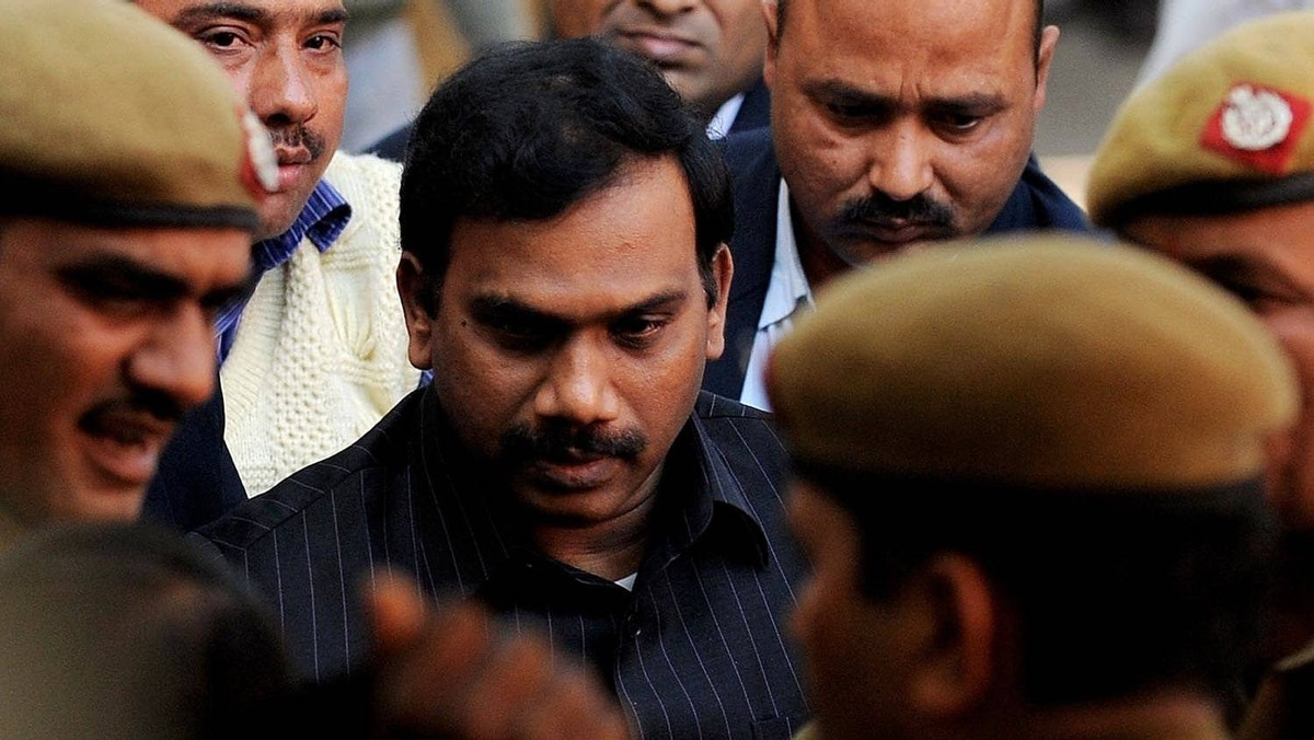 India's former telecoms minister Andimuthu Raja is escorted to court in New Delhi on Feb. 8, 2011.