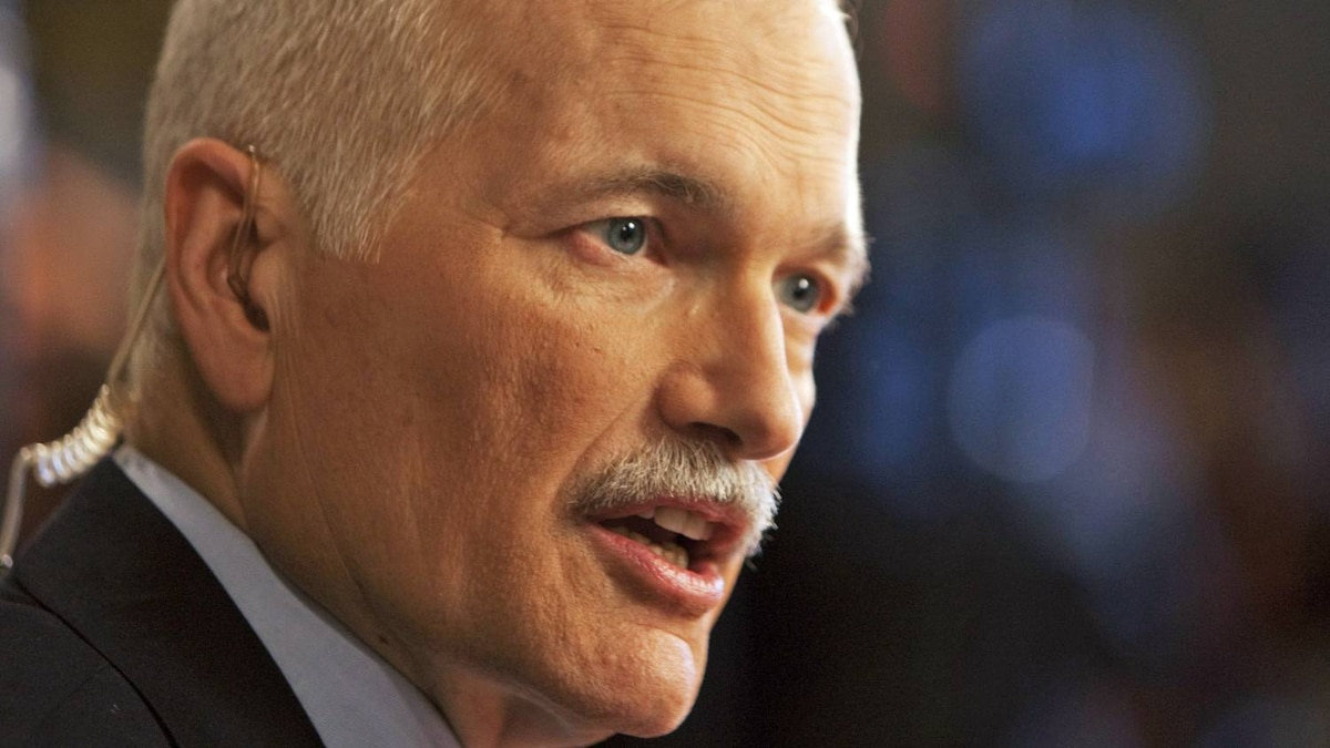 NDP leader Jack Layton speaks with the media in the foyer of the House of Commons following the tabling of the federal budget on Parliament Hill in Ottawa on March 22, 2011.
