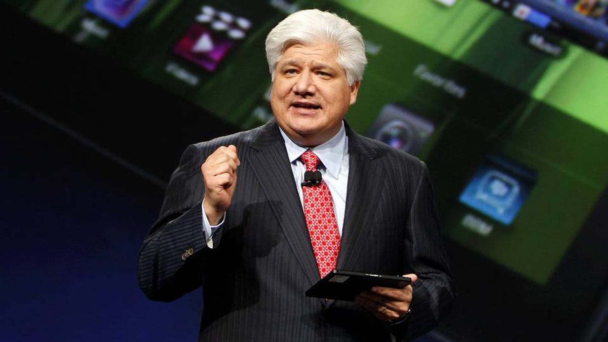 Mike Lazaridis, president and co-chief executive officer of Research in Motion, holds the new Blackberry PlayBook with a screen projection of the device as he speaks at the RIM Blackberry developers conference in San Francisco, Sept. 27, 2010.