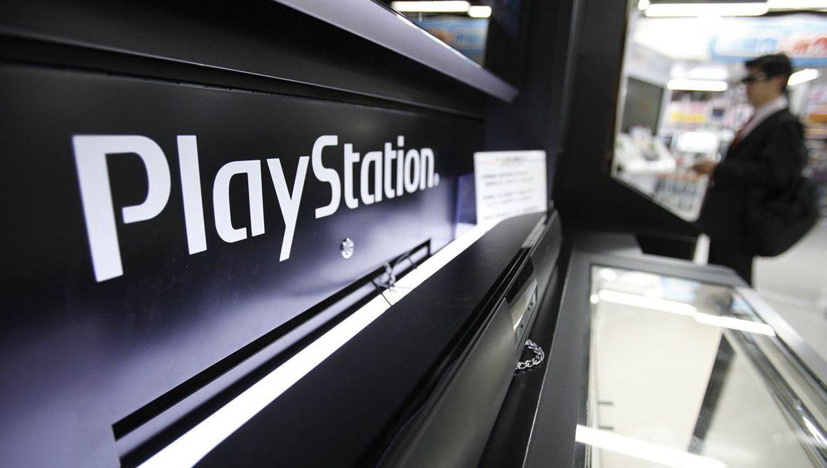 A man plays a game on Sony Corp's PlayStation 3 game console