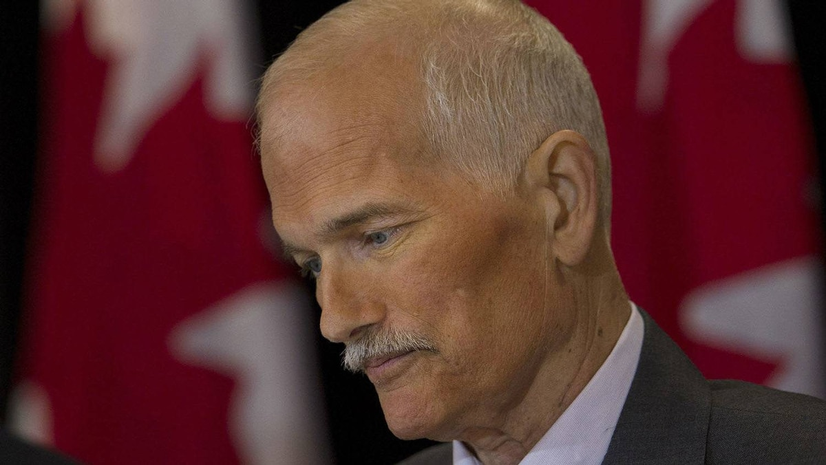 NDP Leader Jack Layton pauses at a new conference in Toronto on Monday, July 25, 2011.