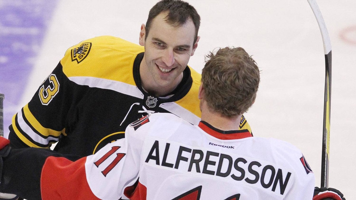 Boston Bruins' Zdeno Chara (33) is congratulated by Ottawa Senators' Daniel Alfredsson after Chara won the hardest shot event at NHL All Star Skills competition in Ottawa Saturday January 28, 2012.THE CANADIANPRESS /Fred Chartrand