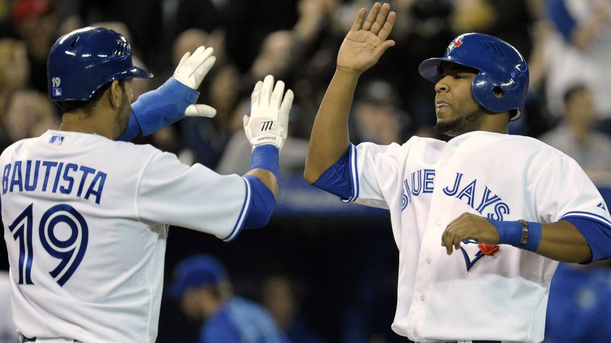 Toronto Blue Jays base runners Jose Bautista and Edwin Encarnacion (R) celebrate after scoring runs against the Seattle Mariners during the eighth inning of their MLB American League baseball game in Toronto April 29, 2012. REUTERS/Mike Cassese