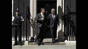 Prime Minister Stephen Harper stands with the recently elected British Prime Minister David Cameron at 10 Downing Street in London, in this picture taken Thursday, June 3, 2010.