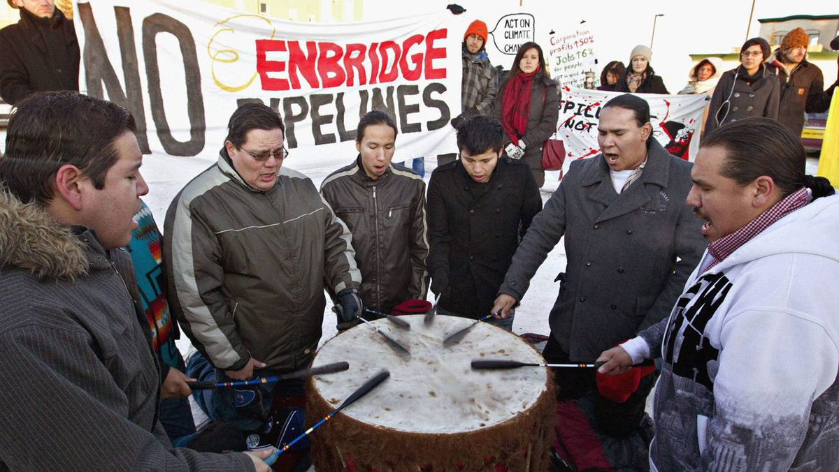 First-nations drummers take part in a rally outside an Edmonton hotel where a hearing is being held into the Enbridge Northern Gateway pipeline project.