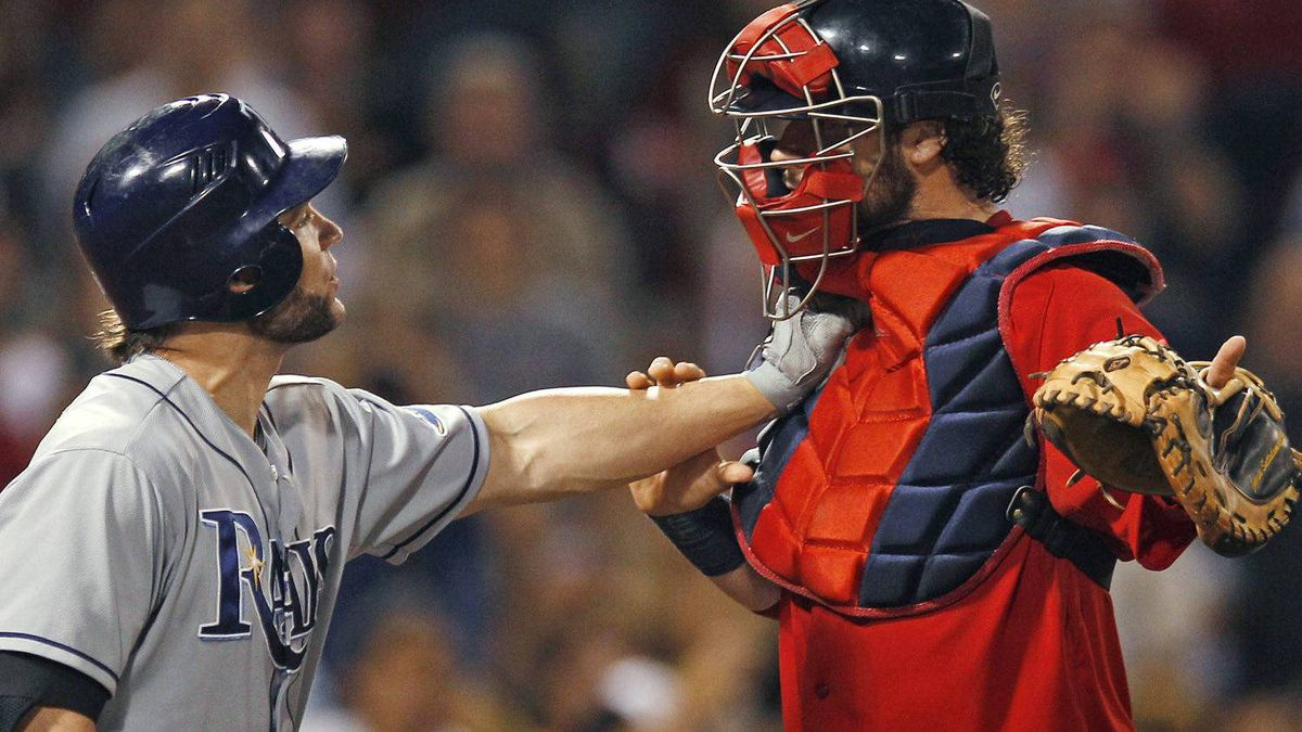 Tampa Bay Rays designated hitter Luke Scott holds off Boston Red Sox catcher Jarrod Saltalamacchia as benches clear after Scott was hit by a pitch thrown by Red Sox's Franklin Morales in the ninth inning of a baseball game at Fenway Park in Boston, Friday, May 25, 2012. Tampa Bay won 7-4. (AP Photo/Charles Krupa)