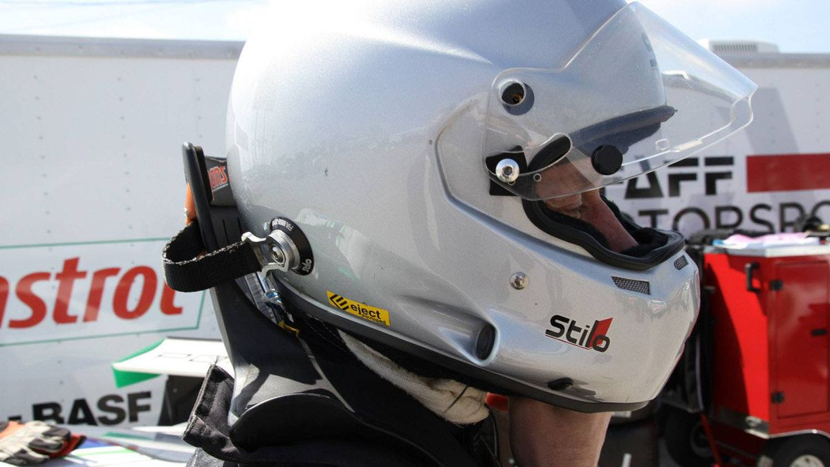 Shaun McKaigue's helmet is linked to a restraint system known as a HANS Device, which limits the forward movement of a drivers' head in an impact. The HANS Device is now mandatory in many racing classes. Crashes like the one that killed NASCAR legend Dale Earnhardt in 2001 highlighted the need for systems that limit head movement.