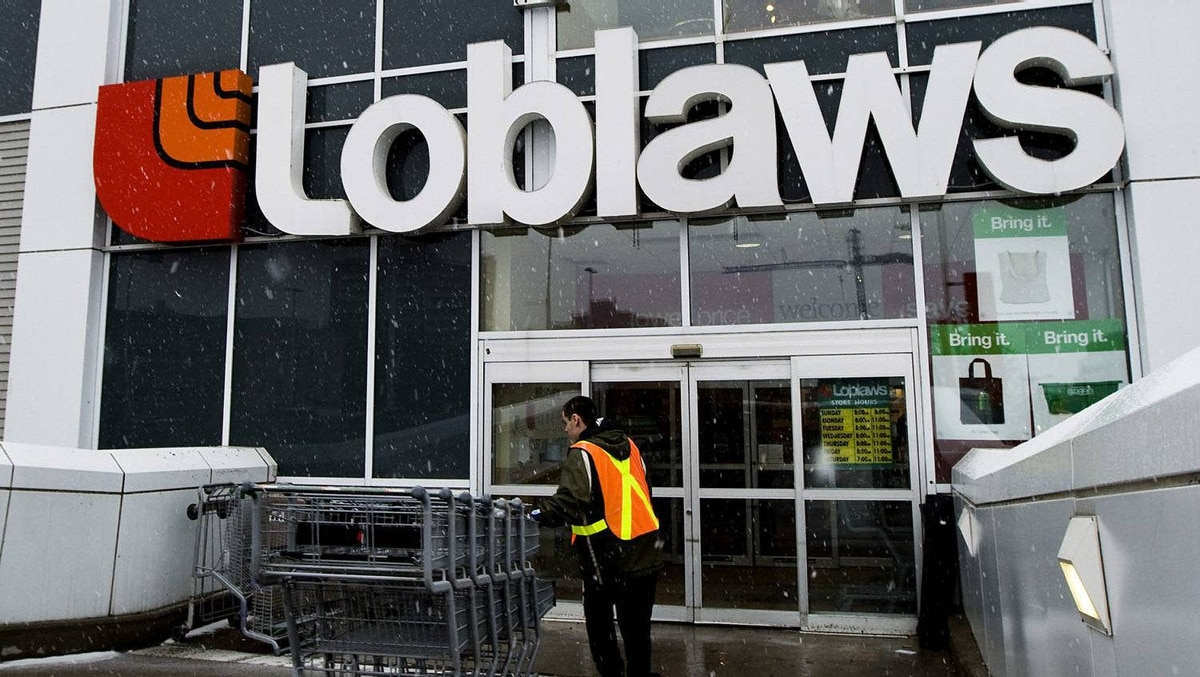 A Loblaws employee brings in shopping carts in Toronto on Wednesday, Feb. 18, 2009.