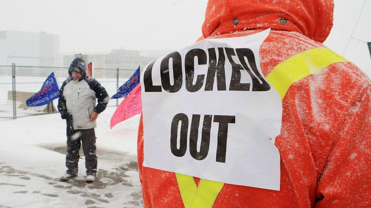 Locked-out workers and supporters picket at the Electro-Motive plant in London, Ont., in January.