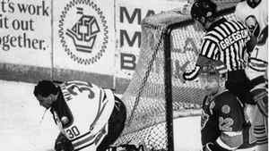 Buffalo Sabres goalie Clint Malarchuk clutches his throat after suffering a lacerated neck in this March 22, 1989 photo in Buffalo, N.Y. THE CANADIAN PRESS/AP, Harry Scull Jr.