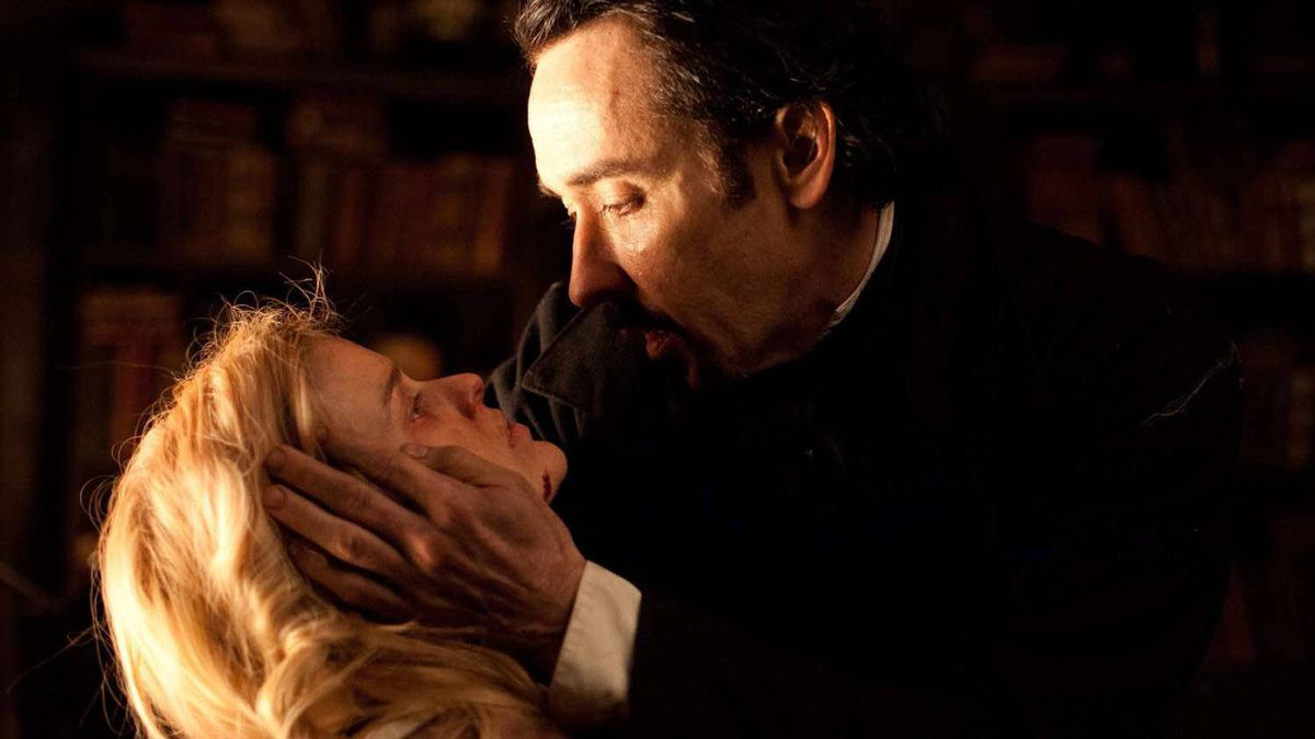 "John Cusack portrays Edgar Allan Poe nd Alice Eve portrays Emily Hamilton in a scene from the gothic thriller ""The Raven."""