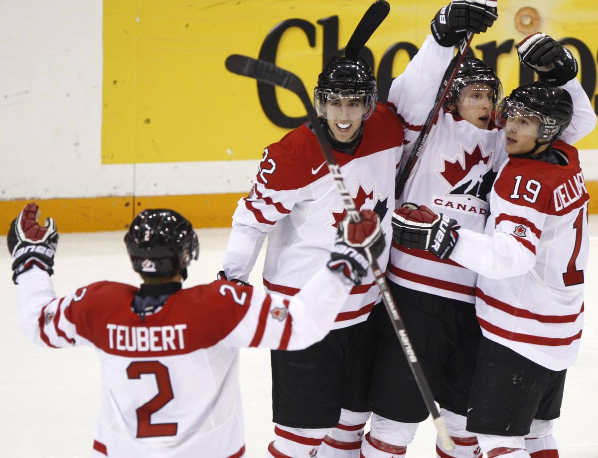 Team Canada Colten Teubert, Jared Cowen, Luke Adam and Stefan Della Rovere, left to right, celebrate a goal by Adam against Team Slovakia during second period action at the World Junior Hockey Championship in Saskatoon, Sask., on Tuesday, Dec. 29, 2009. THE CANADIAN PRESS/Nathan Denette