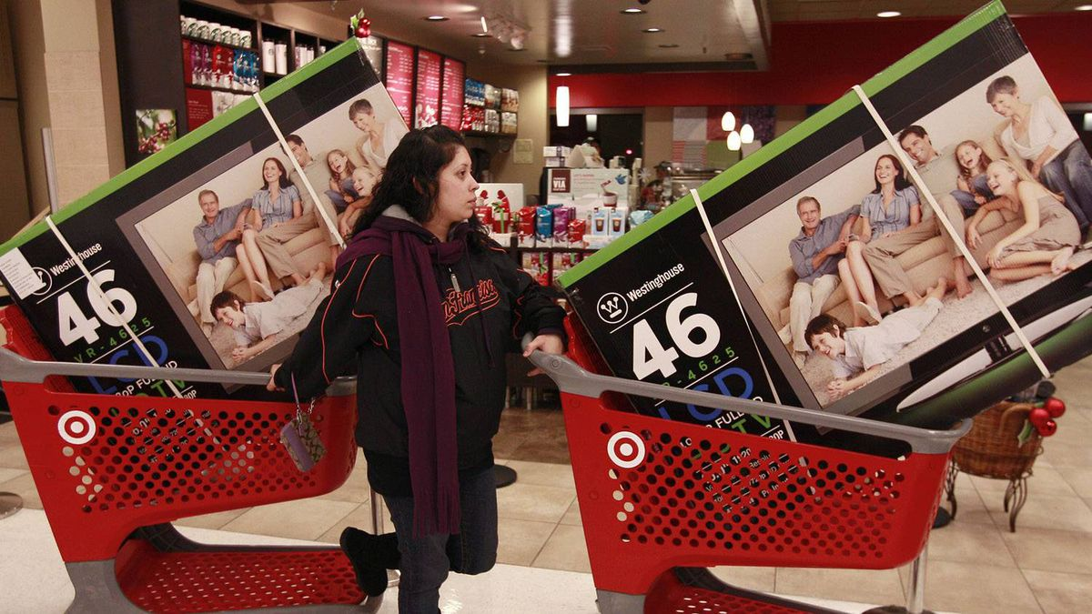 Target customer Nancy, last name not given, waits with televisions purchased at aTarget Store in Colma, Calif., Friday, Nov. 25, 2011.
