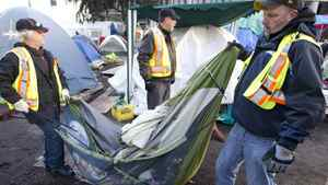 City of Vancouver workers remove an unoccupied tent at the Occupy Vancouver site on the Vancouver Art Gallery grounds Nov. 15, 2011.