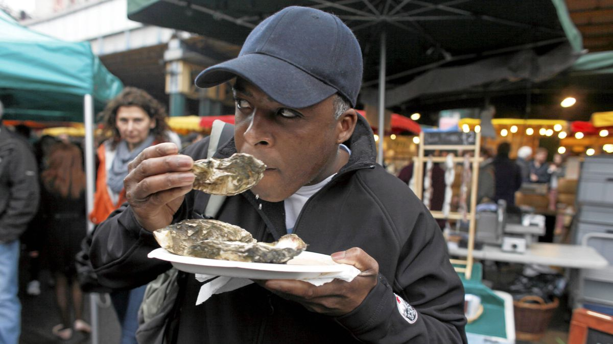 Dean Jacobs of Calgary tries the oysters at the famous Borough Market in London, England.