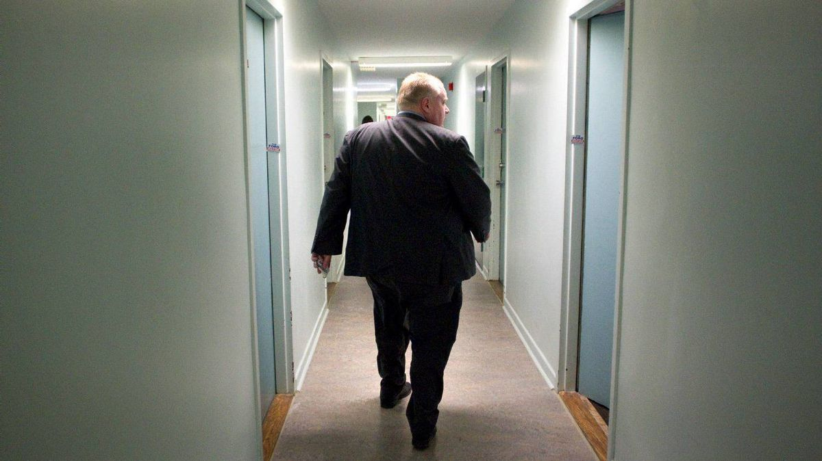 Toronto's Mayor Rob Ford walks down a hallway during a tour of a Toronto community housing building in the city's east end on Feb. 16, 2012.