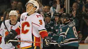 Dion Phaneuf of the Calgary Flames skates away as the San Jose Sharks celebrate a goal during a game in San Jose on January 18, 2010 (Jed Jacobsohn/Getty Images)