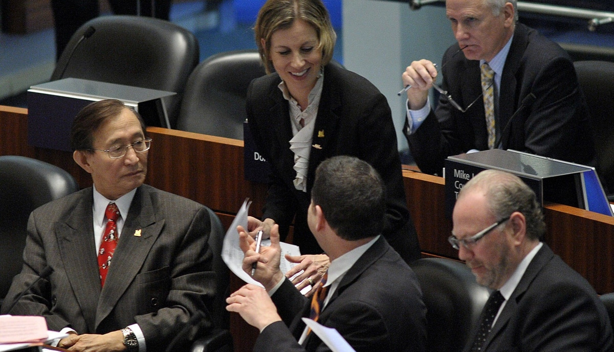 TTC Chair and Councillor, Karen Stintz, top, talks with councillors during an emergency meeting of Toronto City Council called to challenge mayor Rob Ford's Uniliteral move to kill Transit City, Februay 8, 2012.