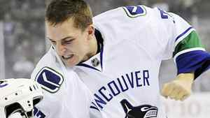 Vancouver Canucks' Rick Rypien fights Edmonton Oilers' Zach Stortini during first period NHL hockey action in Edmonton on Monday, October 19, 2009. Rypien has been suspended indefinitely for grabbing a fan on Tuesday night. THE CANADIAN PRESS/Jimmy Jeong