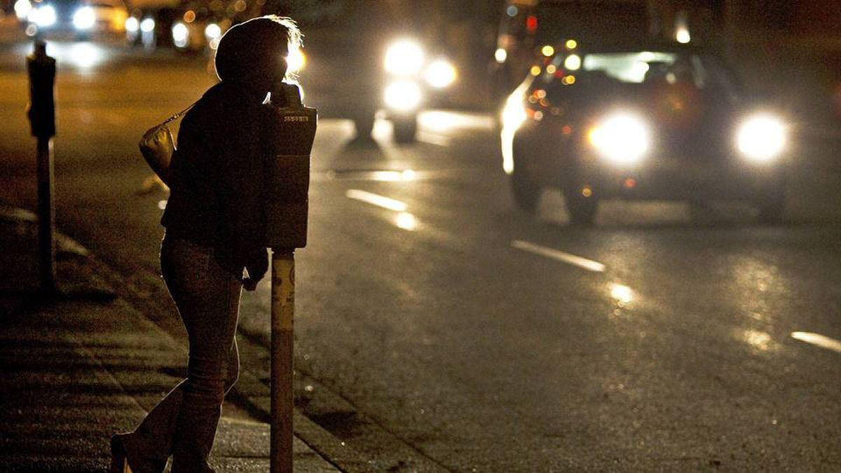 A prostitute looks for customers in Vancouver's Downtown Eastside on Feb. 9, 2009.