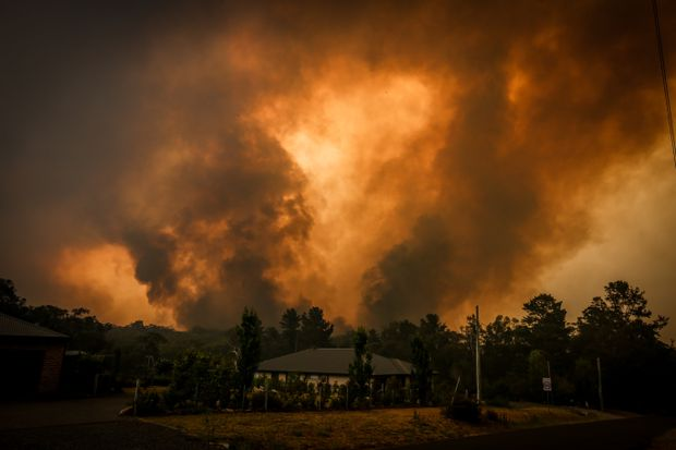 Australia's PM defends climate stance amid wildfire disaster